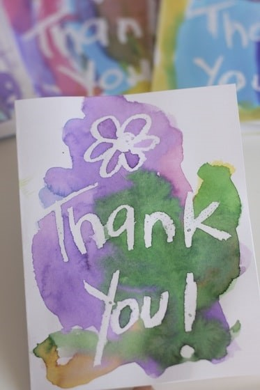 "A handmade watercolor painted card that says ""Thank you"""