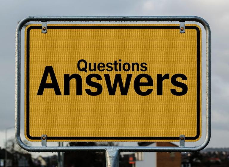 """Street Sign that has """"Questions Answers"""" printed on it"""